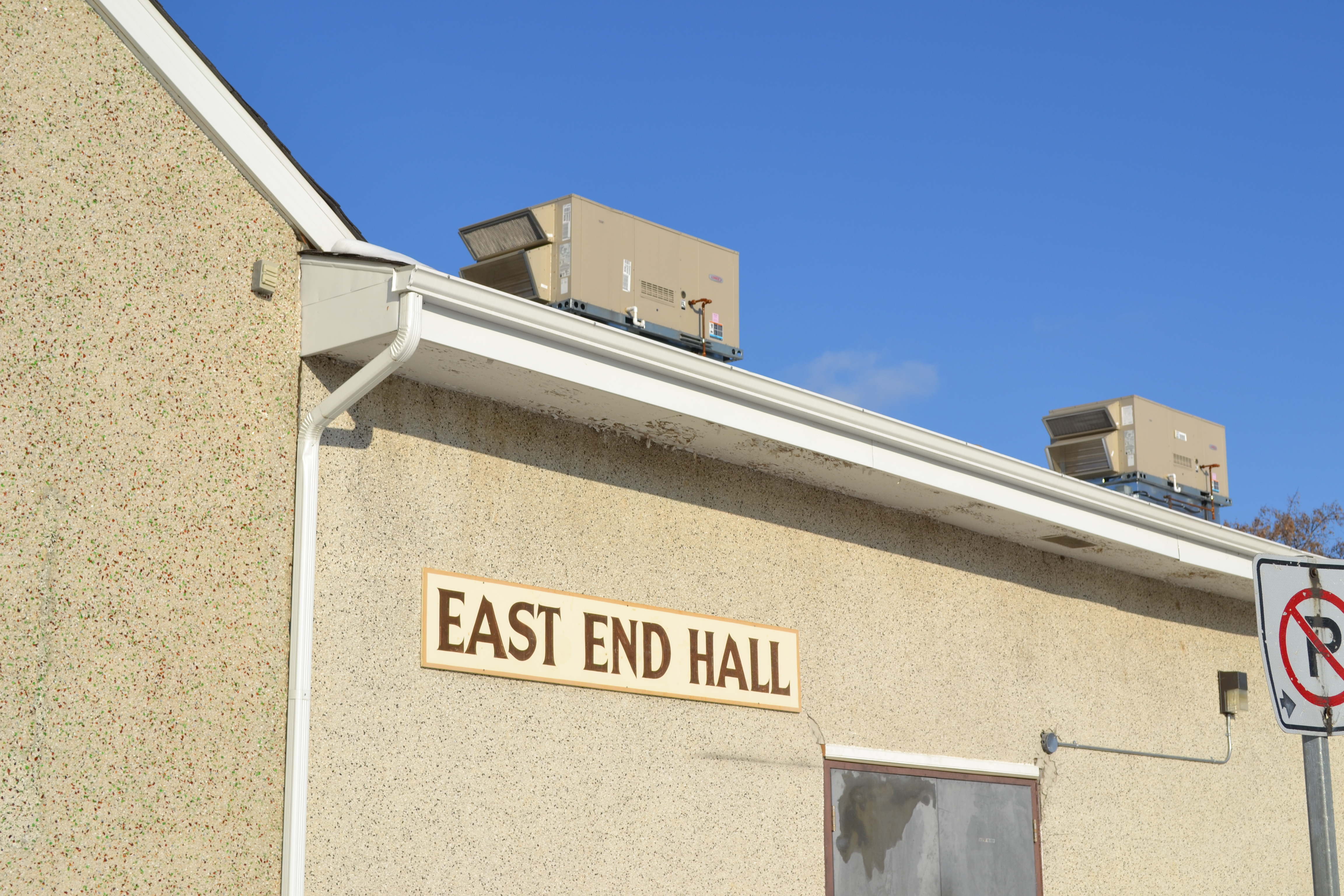 East End Hall  new eaves trough and 2 new air conditioners.jpg