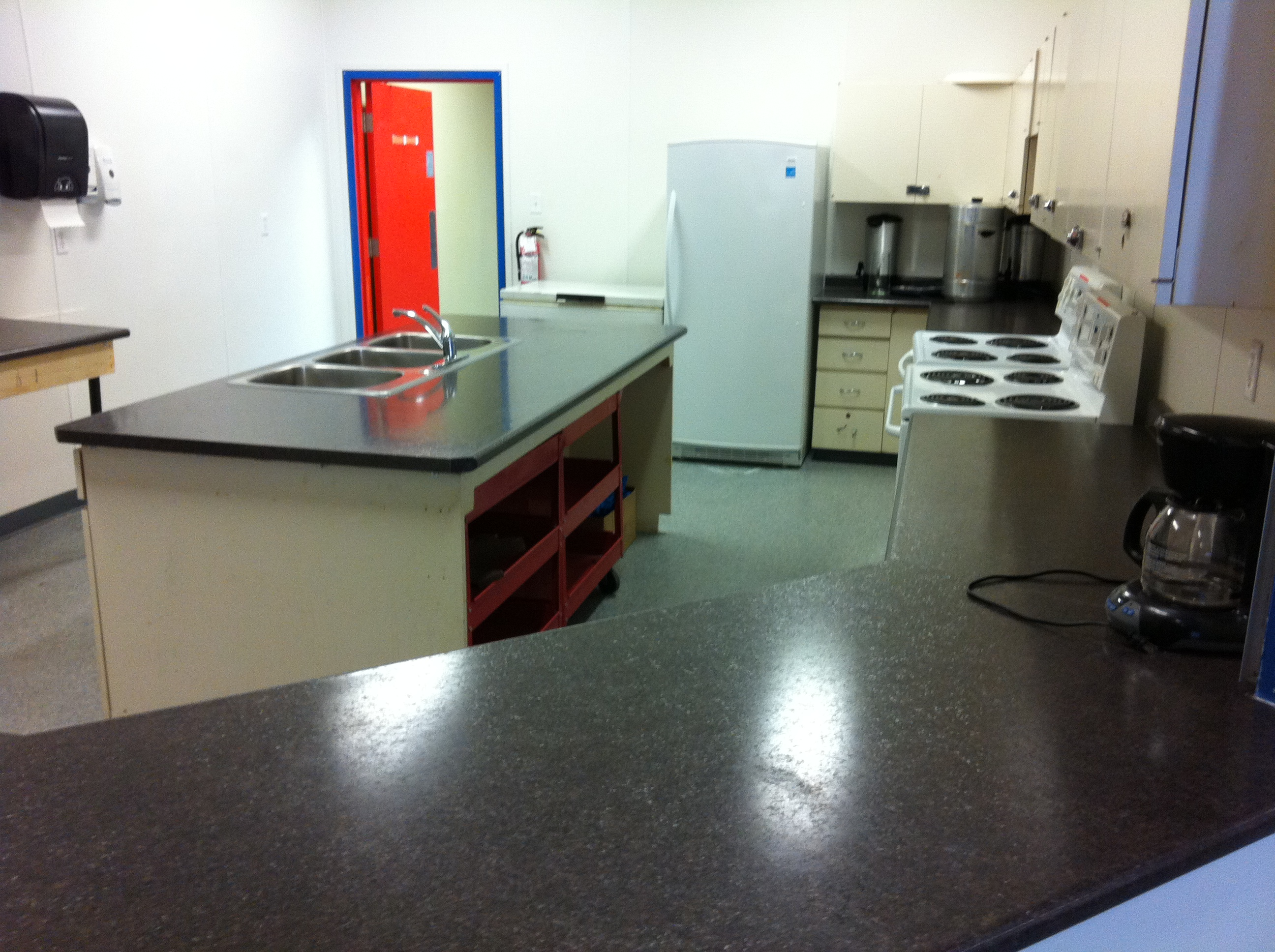 CP 2012 Hall Kitchen new counter tops and entrance door.JPG